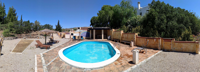 Panoramica piscina privada arco iris